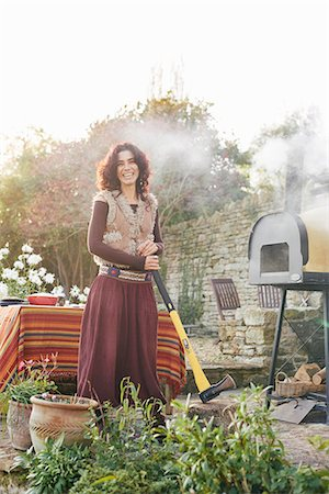 furry - Portrait of mature hippy female with axe in garden Stock Photo - Premium Royalty-Free, Code: 649-08004224