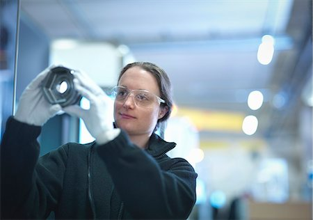 Female engineer inspecting part in factory Stock Photo - Premium Royalty-Free, Code: 649-08004244