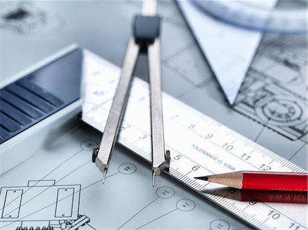 Drawing equipment sitting on engineering drawing Stock Photo - Premium Royalty-Free, Code: 649-08003915