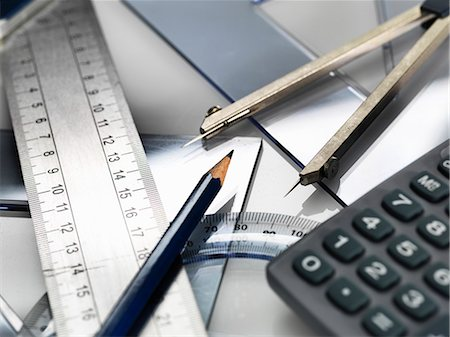Drawing equipment, sitting on engineering technical drawing Stock Photo - Premium Royalty-Free, Code: 649-08003925