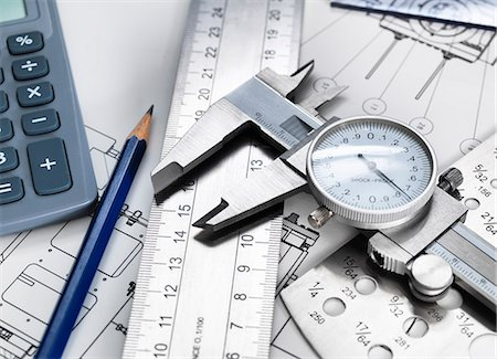 Dial caliper and engineering measurement equipment, sitting on technical drawing Stock Photo - Premium Royalty-Free, Code: 649-08003926