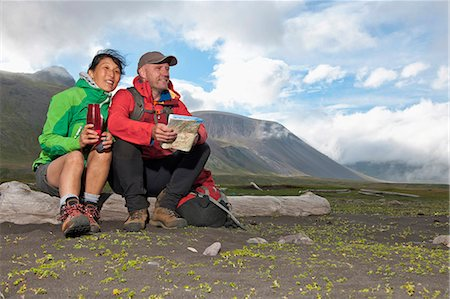 fitness   mature woman - Mature hiking couple sitting with drinks flask and map, Breidvik, Borgafjordur East, East Iceland Stock Photo - Premium Royalty-Free, Code: 649-08003938