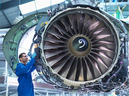Engineers working on aircraft engine in aircraft maintenance factory Stock Photo - Premium Royalty-Free, Code: 649-08060076