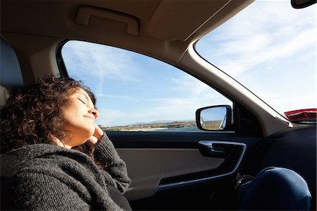 road trip - Woman sleeping inside car, Connemara, Ireland Stock Photo - Premium Royalty-Free, Code: 649-08060242