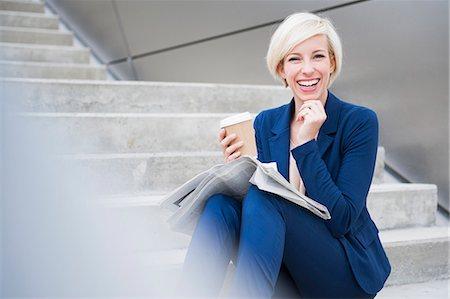 Businesswoman taking coffee break on steps Stock Photo - Premium Royalty-Free, Code: 649-08060262