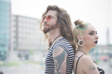 Portrait of punk hippy couple back to back on city street Stock Photo - Premium Royalty-Free, Code: 649-08060331