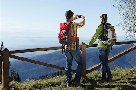 Hikers taking photograph of mountains, Montseny, Barcelona, Catalonia, Spain Stock Photo - Premium Royalty-Free, Code: 649-08060458