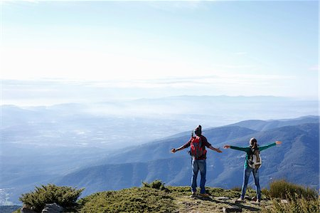 Hikers enjoying view from hilltop, Montseny, Barcelona, Catalonia, Spain Stock Photo - Premium Royalty-Free, Code: 649-08060465