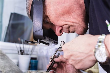 Close up of jewellery craftsman using miniature blowtorch Stock Photo - Premium Royalty-Free, Code: 649-08060764