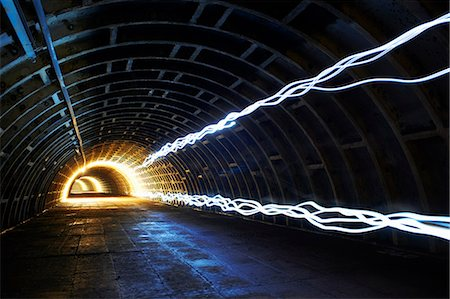 Light trails in tunnel Stock Photo - Premium Royalty-Free, Code: 649-08060858