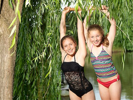 preteen bathing suit - Two sisters hanging on swing beside lake Stock Photo - Premium Royalty-Free, Code: 649-08060885
