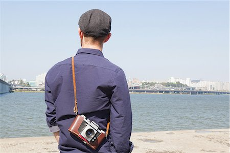 Rear view of male tourist looking at view of river, Seoul, South Korea Stock Photo - Premium Royalty-Free, Code: 649-08084643