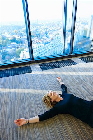 Mature woman practising yoga in room Stock Photo - Premium Royalty-Free, Code: 649-08084773