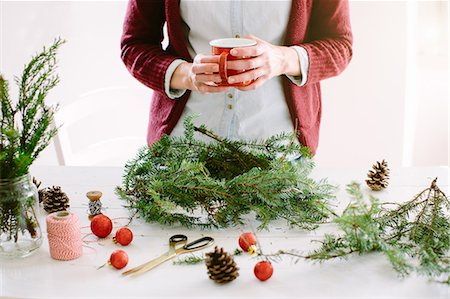 Woman decorating Christmas wreath Stock Photo - Premium Royalty-Free, Code: 649-08084789