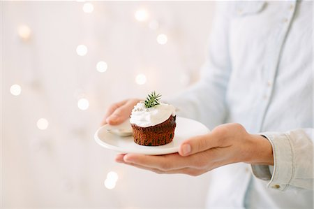 Chocolate cupcakes topped with whipped cream Stock Photo - Premium Royalty-Free, Code: 649-08084797