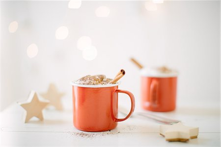 Chocolate milk topped with whipped cream, cocoa powder & cinnamon stick Stock Photo - Premium Royalty-Free, Code: 649-08084798