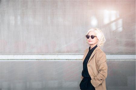 single mature people - Portrait of mature businesswoman, wearing sunglasses Stock Photo - Premium Royalty-Free, Code: 649-08085077