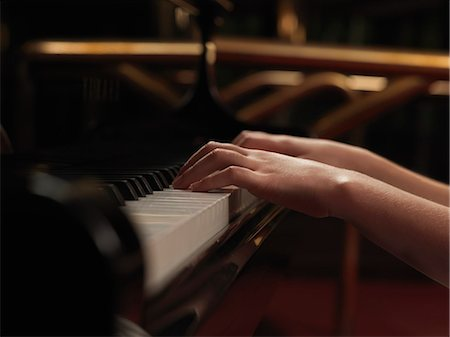 preteens fingering - Close up of girls hands playing piano keys Stock Photo - Premium Royalty-Free, Code: 649-08085139