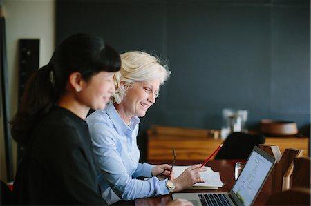 Two mature businesswomen having informal office meeting Stock Photo - Premium Royalty-Free, Code: 649-08085236