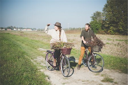 stick - Young couple cycling in countryside, Dolo, Venice, Italy Stock Photo - Premium Royalty-Free, Code: 649-08085357