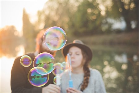 Young couple playing with bubbles Stock Photo - Premium Royalty-Free, Code: 649-08085385