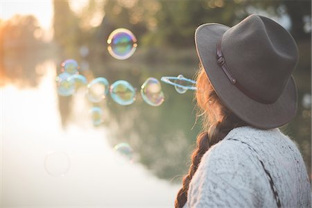Young woman blowing bubbles Stock Photo - Premium Royalty-Free, Code: 649-08085386