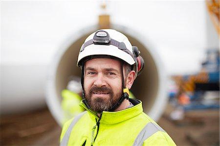 Portrait of engineer at wind farm Stock Photo - Premium Royalty-Free, Code: 649-08085537