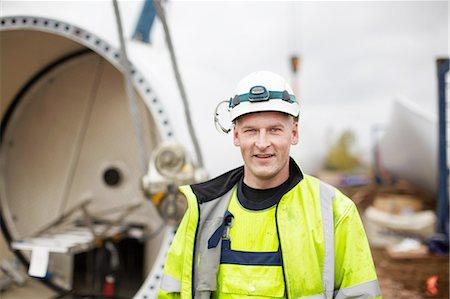 Portrait of engineer at wind farm Stock Photo - Premium Royalty-Free, Code: 649-08085538