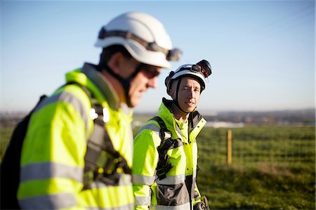 Two engineers at wind farm, walking together Stock Photo - Premium Royalty-Free, Code: 649-08085567