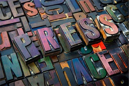 Letterpress letters spelling the word Press Stock Photo - Premium Royalty-Free, Code: 649-08085612
