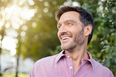 Handsome smiling mature man on street Stock Photo - Premium Royalty-Free, Code: 649-08085736
