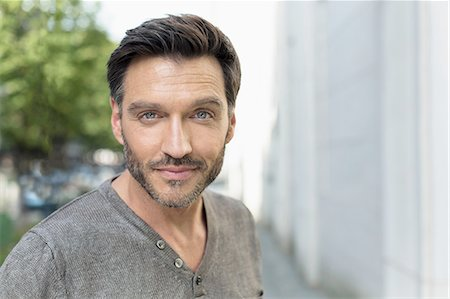 Portrait of handsome mature man on city street Stock Photo - Premium Royalty-Free, Code: 649-08085731