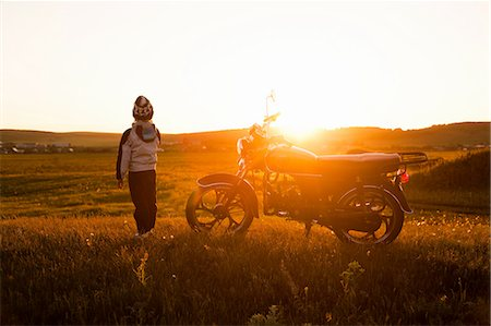 enjoying - Rear view of boy and motorcycle at sunset, Sarsy village, Sverdlovsk Region, Russia Stock Photo - Premium Royalty-Free, Code: 649-08085797