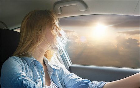 Woman driving car and watching sunset Stock Photo - Premium Royalty-Free, Code: 649-08085864