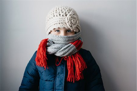 Girl warmly wrapped up in woollen hat and scarf Stock Photo - Premium Royalty-Free, Code: 649-08085905