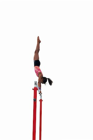 preteen girls gymnastics - Young gymnast performing on uneven bars Stock Photo - Premium Royalty-Free, Code: 649-08085965