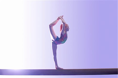 preteen girls stretching - Young gymnast performing on balance beam Stock Photo - Premium Royalty-Free, Code: 649-08085969