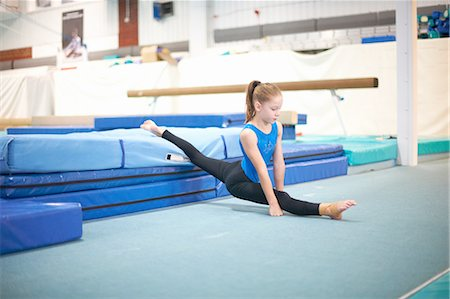 preteen girls gymnastics - Young gymnast practising moves Stock Photo - Premium Royalty-Free, Code: 649-08085960