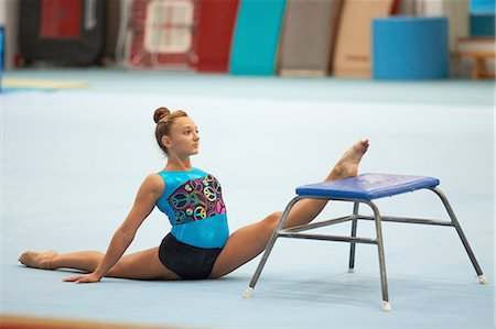 Young gymnast practising moves Stock Photo - Premium Royalty-Free, Code: 649-08085961