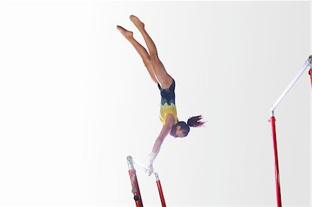 preteen girls gymnastics - Young gymnast performing on uneven bars Stock Photo - Premium Royalty-Free, Code: 649-08085963