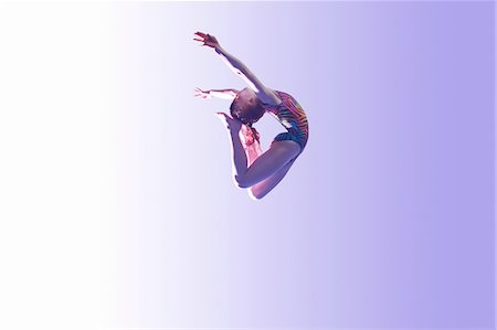 preteen girls gymnastics - Young gymnast in mid-air leap Stock Photo - Premium Royalty-Free, Code: 649-08085971