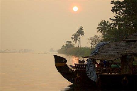 Boat on water at sunrise, Kerala, India Stock Photo - Premium Royalty-Free, Code: 649-08085983