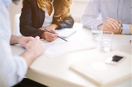 Cropped over the shoulder view of businesswoman signing contract Stock Photo - Premium Royalty-Free, Code: 649-08086123