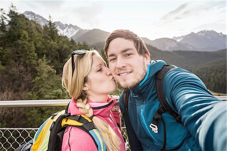 friluftsliv - Young hiking couple taking selfie in mountains, Reutte, Tyrol, Austria Stock Photo - Premium Royalty-Free, Code: 649-08086380