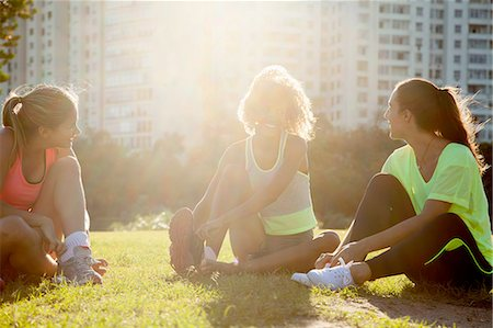 exercising - Three young women tying trainer laces in  park Stock Photo - Premium Royalty-Free, Code: 649-08086448