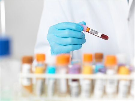 Close up of scientists hands selecting a blood sample for medical testing Stock Photo - Premium Royalty-Free, Code: 649-08086465