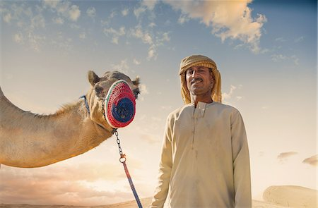 Portrait of camel and bedouin in desert, Dubai, United Arab Emirates Stock Photo - Premium Royalty-Free, Code: 649-08086473