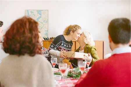 Girl thanking grandmother for gift at family Christmas party Stock Photo - Premium Royalty-Free, Code: 649-08086582
