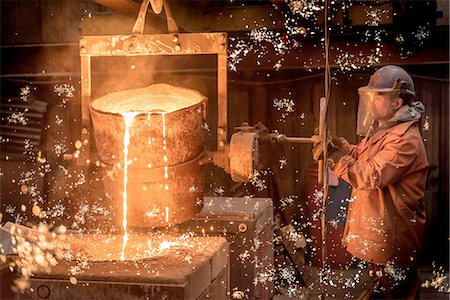 pouring - Worker pouring molten metal in foundry Stock Photo - Premium Royalty-Free, Code: 649-08086735