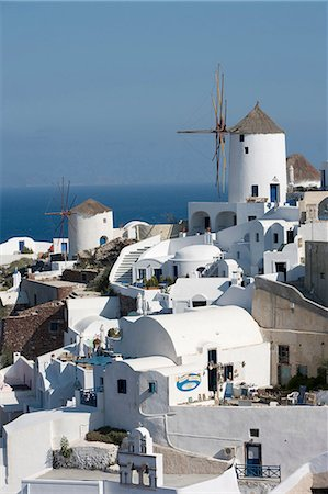View of white washed hillside town and windmill, Oia, Santorini, Cyclades, Greece Stock Photo - Premium Royalty-Free, Code: 649-08086767